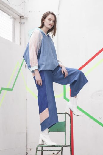 Pastel top over faux leather hoody and denim trouser
